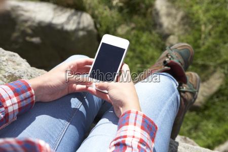teenage, girl, using, mobile, phone, in - 19408600