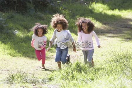 three, children, playing, in, woods, together - 19408822