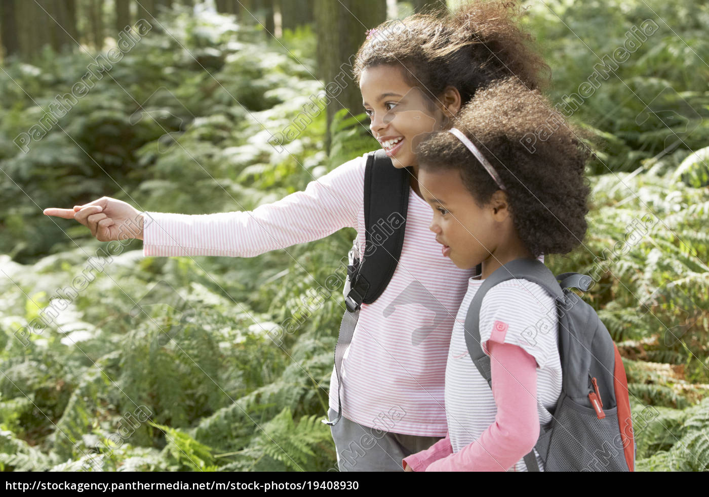 two, girls, exploring, woods, together - 19408930