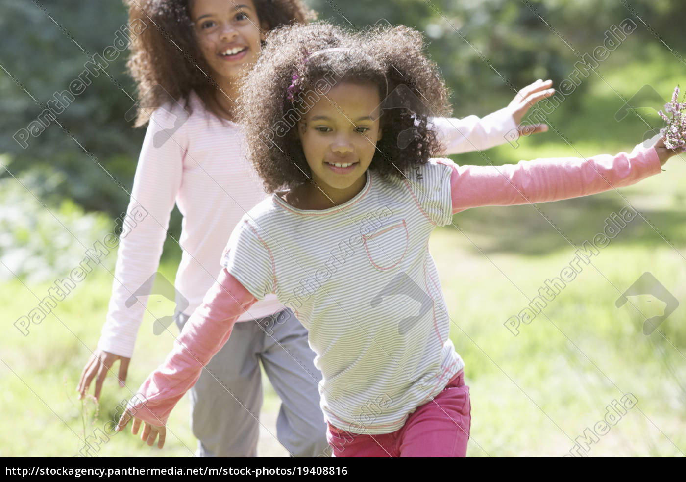 two, girls, playing, in, woods, together - 19408816