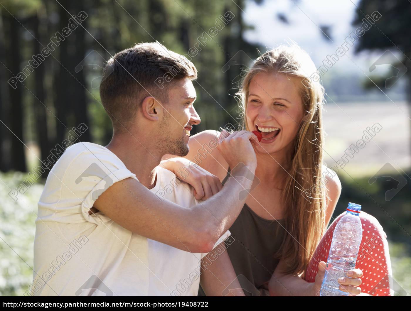 young, couple, enjoying, picnic, in, countryside - 19408722