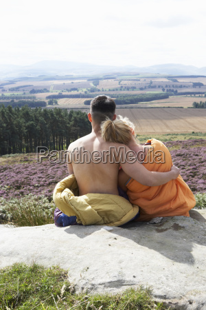 young, couple, in, sleeping, bags, admiring - 19408584