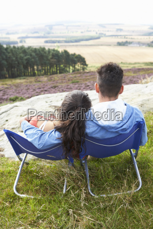 young, couple, sitting, in, chairs, on - 19408576