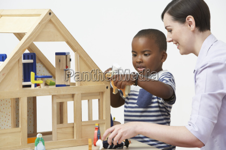 pre school teacher and pupil playing