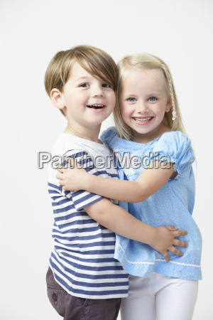 two pre school pupils hugging one