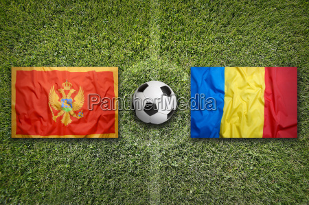 montenegro vs romania flags on soccer