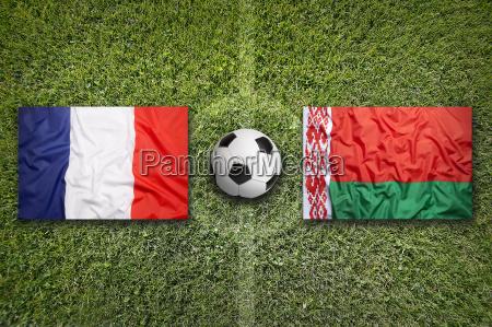 france vs belarus flags on soccer
