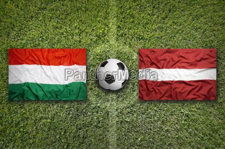 hungary vs latvia flags on soccer