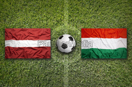 latvia vs hungary flags on soccer
