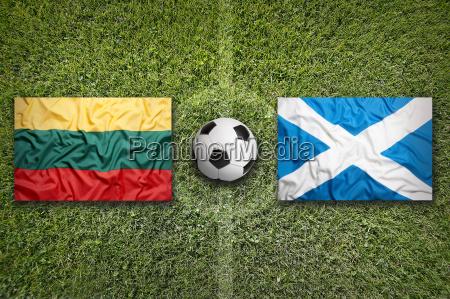 lithuania vs scotland flags on soccer
