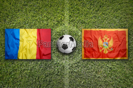 romania vs montenegro flags on soccer