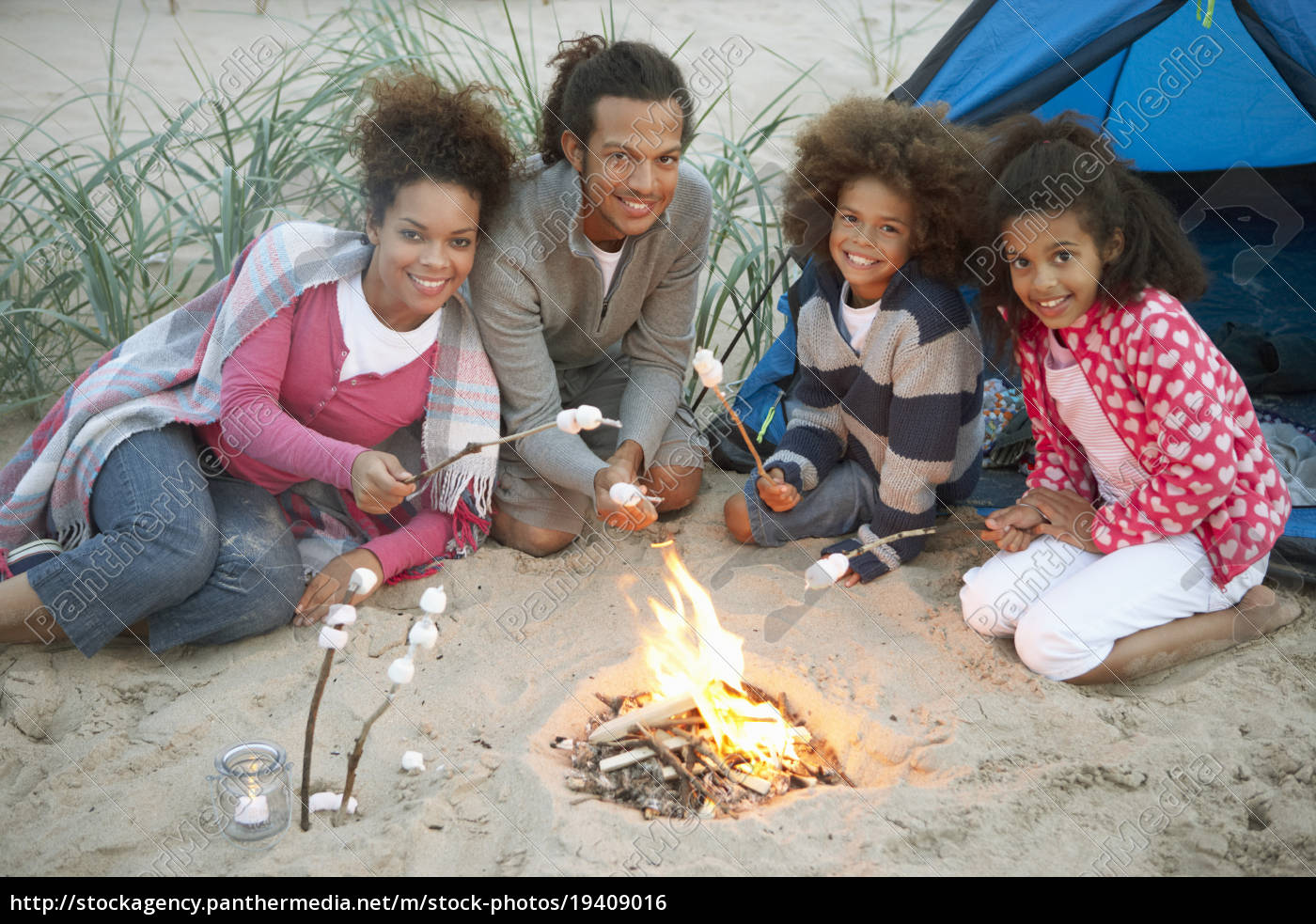 family, camping, on, beach, and, toasting - 19409016
