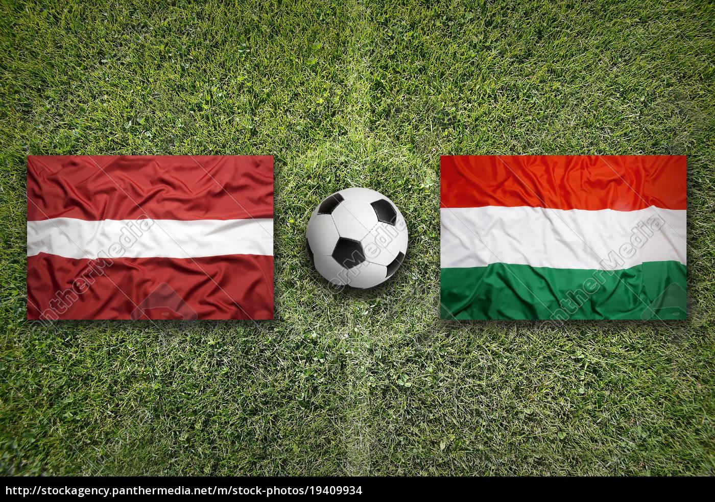 latvia, vs., hungary, flags, on, soccer - 19409934