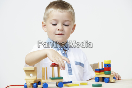 pre-school, pupil, playing, with, wooden, toy - 19409226