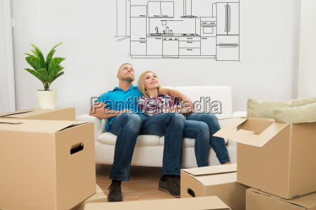 couple, in, new, home, relaxing, on - 19412382