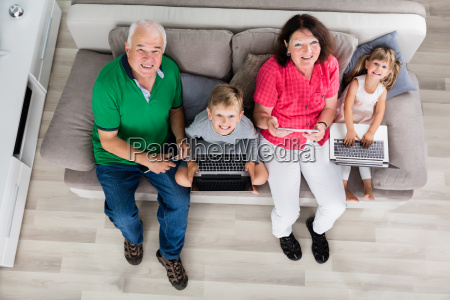 family, with, their, laptop, and, digital - 19412690