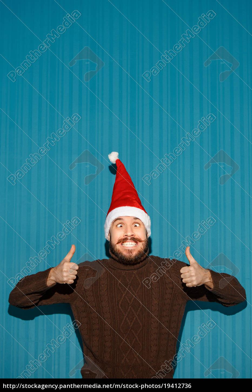 smiling, christmas, man, wearing, a, santa - 19412736