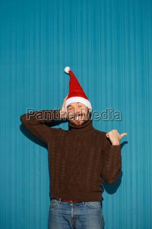 smiling, christmas, man, wearing, a, santa - 19412744
