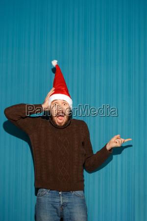 surprised, christmas, man, wearing, a, santa - 19412742