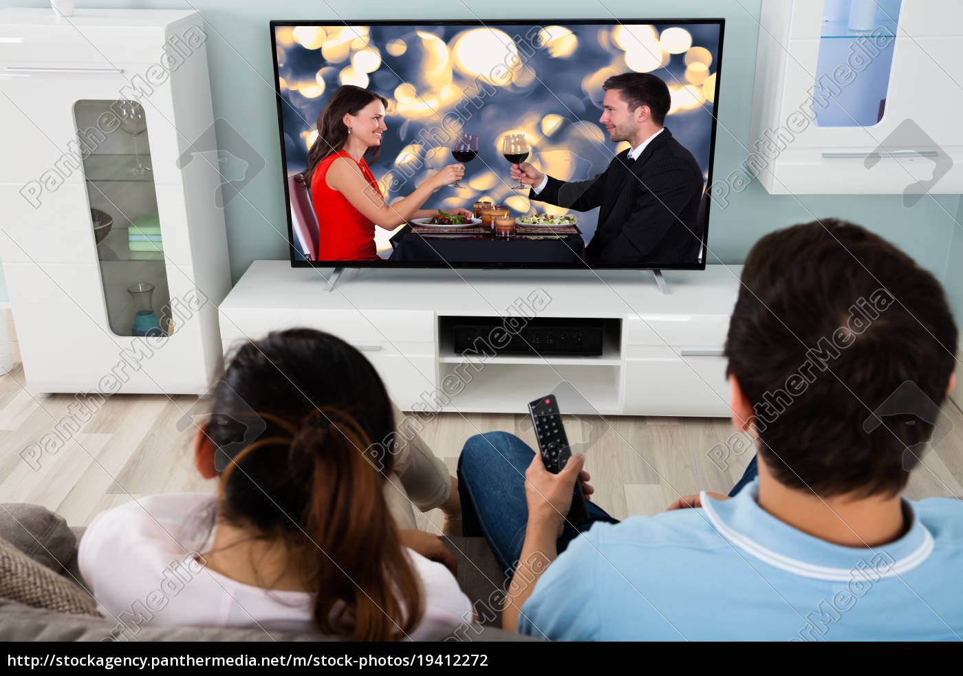 young, couple, watching, movie, together - 19412272