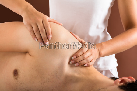 young, man, getting, massage - 19412462