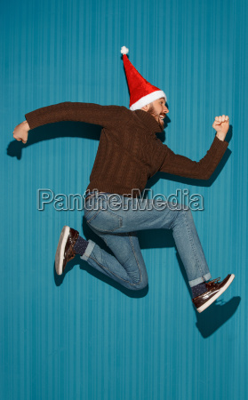 the, running, christmas, man, wearing, a - 19413336