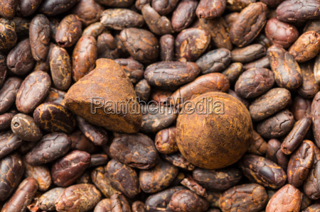 sweet chocolate truffles on cocoa beans