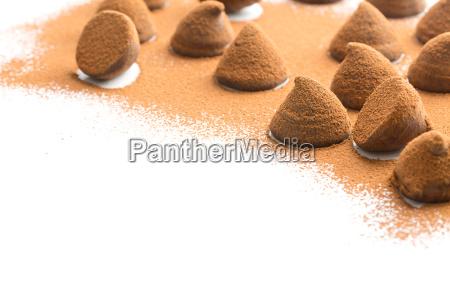sweet chocolate truffles and cocoa powder
