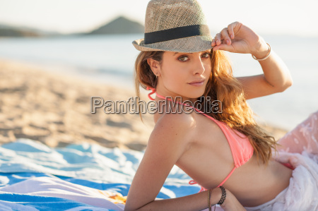 portrait of young woman sunbathing on