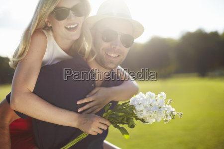 young woman with flowers getting piggy