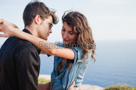 couple standing at cliff