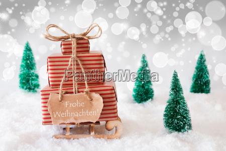 sleigh on white background frohe weihnachten