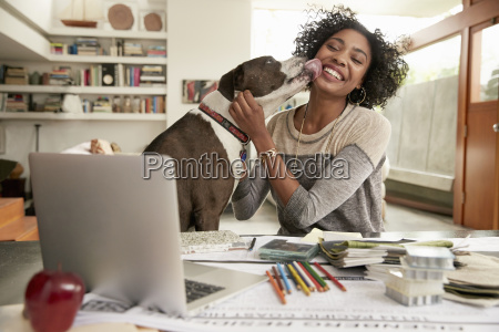 young businesswoman with pet dog in