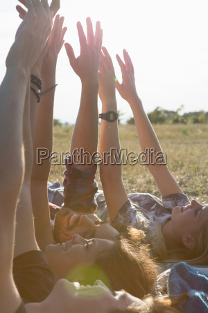 four friends lying on backs with