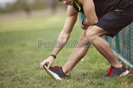 young man touching toes stretching