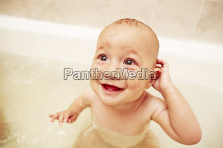 happy baby boy in bathtub
