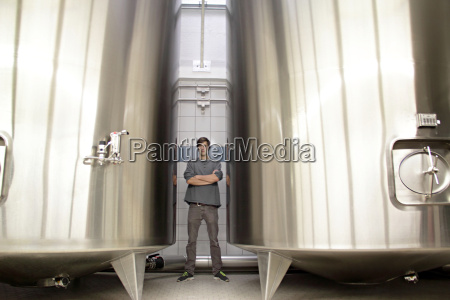 portrait of man by vats in