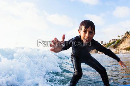 young boy surfing encinitas california usa