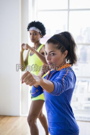 women punching the air