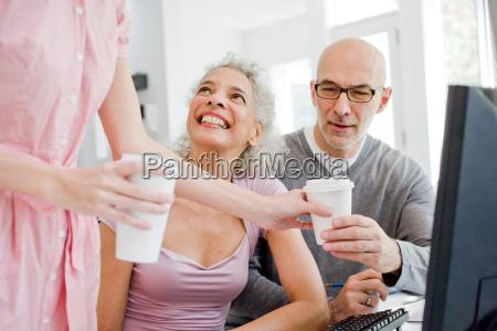 2 business people receiving coffee