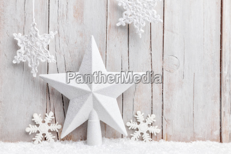 christmas star and snowflakes with snow