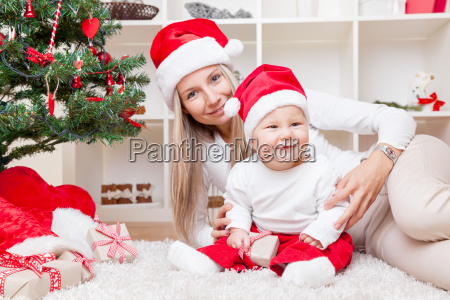 mother with baby boy celebrating christmas