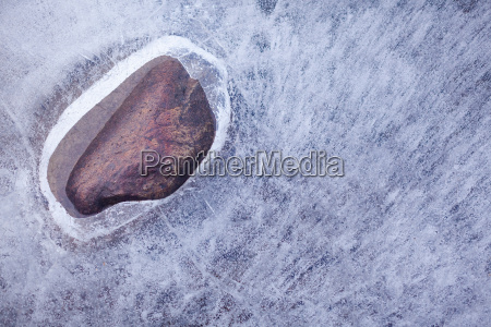 hole in layer of ice on