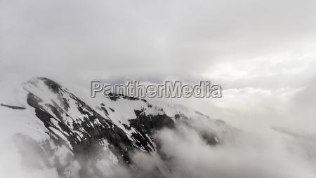 snow cloud and mist over bavarian