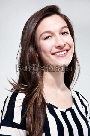 brunette teenage girl smiling