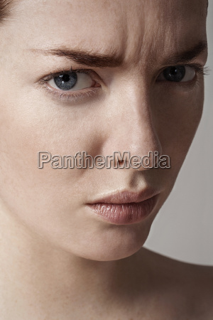 close up of young woman frowning