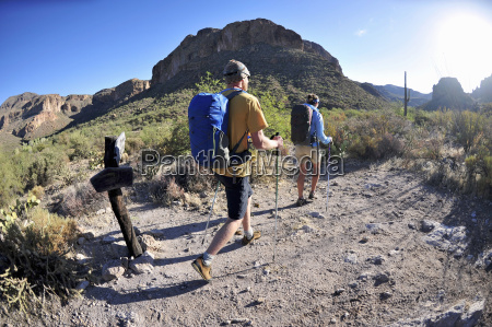 backpacking couple hiking in superstition mountains