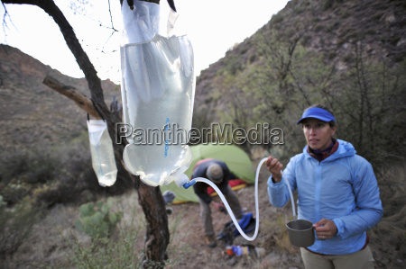 camping couple with inventive water bag
