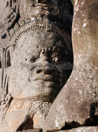 faces carved into the stone of