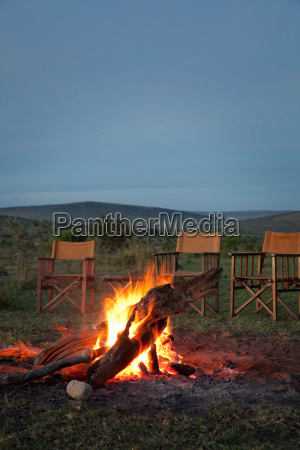 a campfire prepared for sundowners drinks